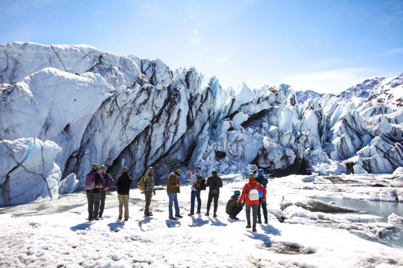 People enjoying a winter tour of the Matanuska Glacier in Alaska